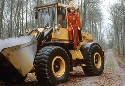 An early version of the Ljung machine's wheel loader with the driver standing in the door.